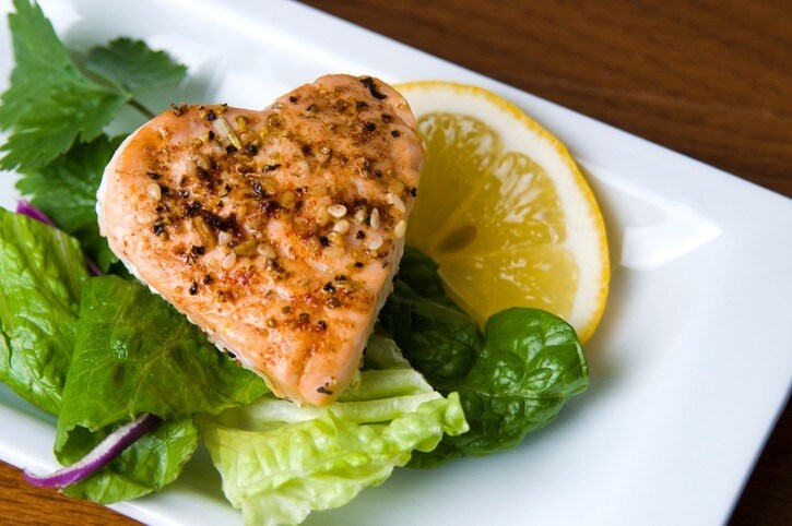 Grilled sesame salmon on green salad.